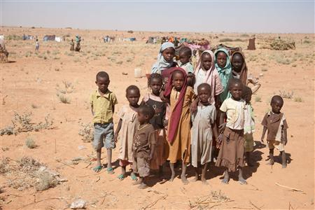 Internally Displaced Persons (IDP) who fled their village following clashes between the Government of Sudan and rebel movements, look on at the Zamzam IDP camp in North Darfur